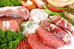 Variety of fresh meat. Garnished with lettuce and parsley, studio shot Stock Image