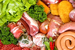 Variety of fresh meat. Garnished with lettuce and parsley, studio shot Stock Images