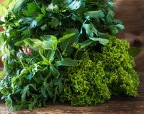 Variety fresh organic herbs on wooden background Stock Photo