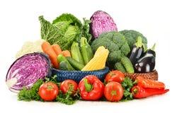 Variety of fresh raw organic vegetables. Composition with variety of fresh raw organic vegetables on white background Royalty Free Stock Photo