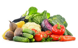 Variety of fresh raw organic vegetables. Composition with variety of fresh raw organic vegetables on white background Stock Photography