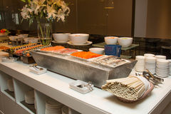 Variety of fresh salads on buffet line Stock Image