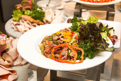 A Variety of fresh salads on buffet line Royalty Free Stock Photography