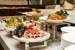 A Variety of fresh salads on buffet line Royalty Free Stock Photos