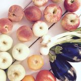 Variety of fresh summer fruits and vegetables - apples, peaches, tomatoes and eggplants. Variety of fresh summer fruits and vegetables - apples, peaches Royalty Free Stock Photos