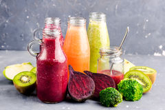 Variety of fresh vegetable and fruits moothie in glass bottles Royalty Free Stock Images