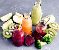 Variety of fresh vegetable and fruits moothie in glass bottles Stock Image