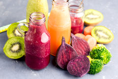 Variety of fresh vegetable and fruits moothie in glass bottles Stock Photo