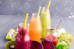 Variety of fresh vegetable and fruits moothie in glass bottles Stock Images
