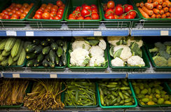 Variety of fresh vegetables on display in grocery store Royalty Free Stock Images
