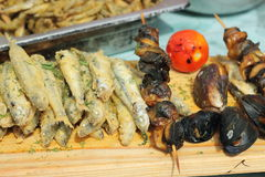 A variety of fried fish. A variety of grilled fish. bokeh. soft focus stock photos
