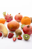 A variety of fruit. Different fruits, from mediterranean to tropical and exotic. Rich in vitamins and colorful. Kiwi and strawberry halved. Mango, orange Royalty Free Stock Image