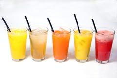 Variety Fruit Juice. Orange mango apple carrot watermelon apple Royalty Free Stock Photo