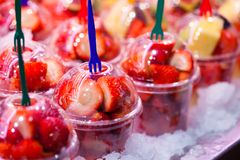 Variety of fruit salad in La Boqueria market in Barcelona. Stock Images