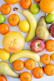 Variety of fruits, apples, tangerines, bananas, pears, lemons, l Stock Photos