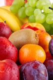 Variety of fruits with drops of water. Composition with fruits with visible drops of water Stock Images