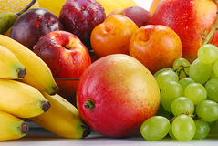 Variety of fruits with drops of water Stock Image