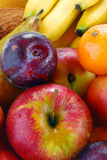 Variety of fruits with drops of water Royalty Free Stock Image