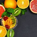 Variety of fruits grapefruit, oranges, kiwi, lemon, mint bunched. Together on a shale board, the concept of healthy eating, copy space, top view set royalty free stock photography