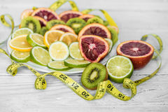 a variety of fruits and measuring tape royalty free stock photo