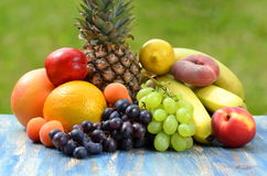 Variety of fruits on table in the garden Royalty Free Stock Image