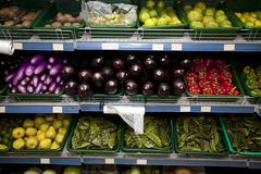 Variety of fruits and vegetables on display in grocery store Stock Photo