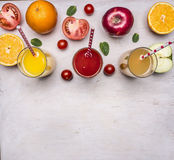 Variety of fruits and vegetables, ingredients for fresh juice glasses with straws border ,text area wooden rustic backgrou Stock Photos