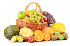 Variety of fruits in wicker basket on white Royalty Free Stock Images