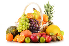 Variety of fruits in wicker basket on white Stock Image