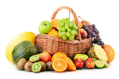 Variety of fruits in wicker basket on white Royalty Free Stock Photography