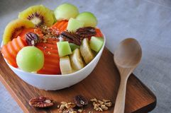 Variety Fruits Yogurt Bowl for Breakfast. Serve on wooden board royalty free stock photo