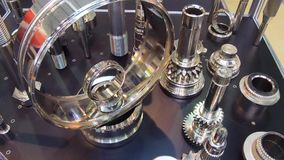 A variety of gears, splined shafts and other metal products. Metal parts are chromed stock footage