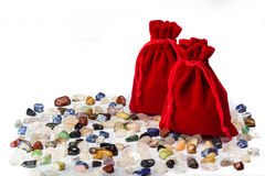 Gemstones. A variety of gemstones and two bags Royalty Free Stock Photos