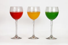 A variety of glasses with colored water. Three glasses with multi-colored water Royalty Free Stock Photography