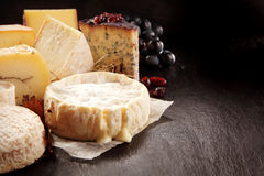 Variety of Gourmet Cheeses on Textured Surface royalty free stock image
