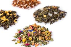 Variety of Gourmet Herbal Tea Blends on White. High Angle Still Life of Variety of Gourmet Herbal Tea Blends in Separate Piles on White Background with Copy Stock Photo
