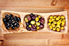 Variety of green, black and mixed marinated olives Stock Image