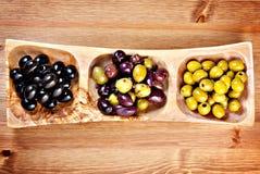 Variety of green, black and mixed marinated olives Stock Image
