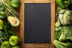 Variety of green vegetables and fruits stock images