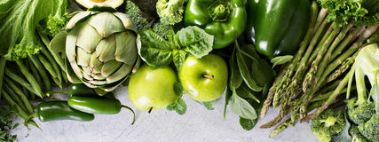 Variety of green vegetables and fruits royalty free stock images