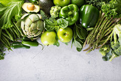 Variety of green vegetables and fruits. Copyspace on white Royalty Free Stock Images