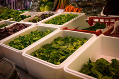 Variety of greenery in boxes at marketplace Royalty Free Stock Photos