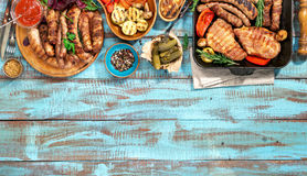 Variety of grilled food on the blue wooden table Stock Photo