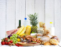 Variety of grocery products fruits vegetables meat cheese Stock Images