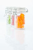 Variety of gummi bears in a preserving jar on white background Royalty Free Stock Images