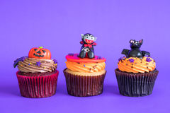 Variety of Halloween cupcakes on background. Royalty Free Stock Photos