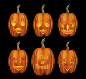 Variety of Halloween Jack O Lanterns. Set of halloween pumpkins with various emotional expressions isolated on a black background Royalty Free Stock Images