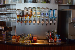 Variety of Hard Liquor bottles at bar counter. Ready for different types of drinks such as on the rocks or cocktail. The liquor brand includes Bombay Sapphire Stock Images