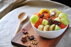 Variety Healthy Fruits on Yogurt Bowl. Put on wooden board stock photography