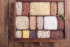 Variety of healthy grains and seeds in a wooden box. Mostly gluten free with rice, quinoa and buckwheat stock photo